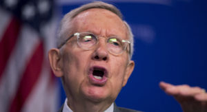 "Senate Minority Leader Harry Reid, D-Nev., speaks at Center for American Progress Action Fund, in Washington, Thursday, March 17, 2016. With the issue coloring this fall's contests for control of the White House and Senate, Democrats have spent weeks trying to link Senate GOP opposition to a court nominee to positions held by Donald Trump, the Republican presidential front-runner abhorred by many Republican leaders. ""Merrick Garland's name hadn't even been mentioned, yet Republicans were already resolved to undermine President Obama,"" Reid said about McConnell's opposition. (AP Photo/Manuel Balce Ceneta)"