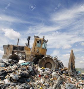 5197897-The-bulldozer-buries-food-and-industrial-wastes-Stock-Photo-landfill-garbage-pollution
