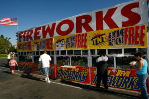 FILLMORE, CA - JUNE 30: Customers buy fireworks for upcoming July 4th celebrations from the Rotary Club of Fillmore Sunrisers fireworks stand on June 30, 2008 in Fillmore, California. Only schools, churches, and other non-profit organizations are allowed to sell fireworks in Fillmore. For some, it is their primary fund-raising event of the year. Last week, President Bush declared a state of emergency for all of California as 1,420 wildfires continue to burn across 550 square miles of central and northern California since being ignited by dry lighting strikes 10 days ago. Because of the high fire danger, Gov. Arnold Schwarzenegger has asked residents to not buy fireworks. Prolonged drought and years of fire suppression are cited by fire officials who predict more dangerous fires this year and a possible repeat of the massive firestorms of 2003 and 2007 that destroyed thousands of homes. (Photo by David McNew/Getty Images)