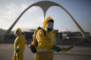 A health worker stands in the Sambadrome as he sprays insecticide to combat the Aedes aegypti mosquitoes that transmits the Zika virus in Rio de Janeiro, Brazil, Tuesday, Jan. 26, 2016. Inspectors begin to spray insecticide around Sambadrome, the outdoor grounds where thousands of dancers and musicians will parade during the city's Feb. 5-10 Carnival celebrations. Brazil's health minister says the country will mobilize some 220,000 troops to battle the mosquito blamed for spreading a virus linked to birth defects. (AP Photo/Leo Correa)